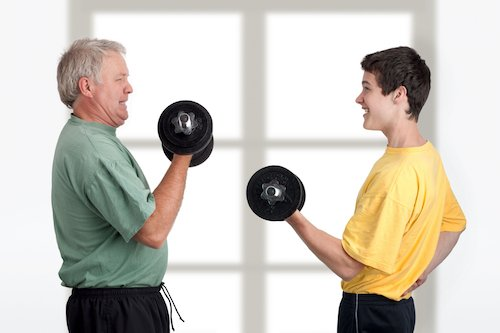 7222517 - father and son doing weight lifting together