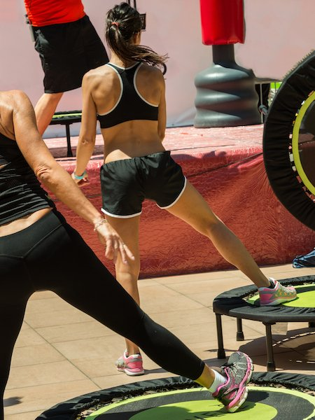 Women doing Fitness on Mini Trampoline