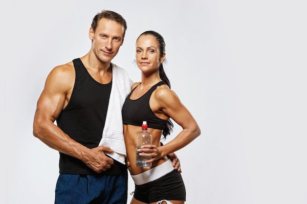 10269625 - athletic man and woman after fitness exercise