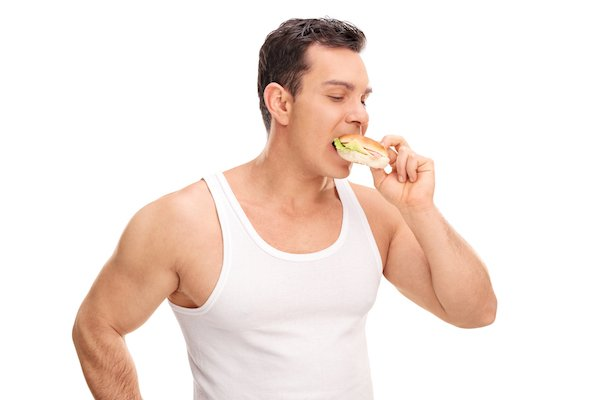 Young man eating a sandwich